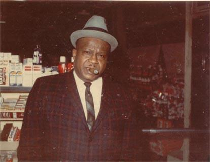 Oswald (Jack Oscar) Sewell standing inside of Gail's Certified Market. It was located on the west side of Chicago.