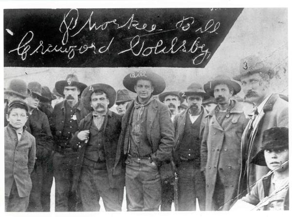 Cherokee Bill [above center with left hand in his pocket], who killed for the pleasure of killing, and his captors, on his arrival in Fort Smith, Arkansas, to face the Hanging Judge. Readig left to right: Zeke Crittenden and Dick Crittenden, deputy marshals; Bill; Clint Scales; Ike Rogers and deputy marshal Bill Smith. Source: http://www.jcs-group.com/oldwest/outlaws/cherokee.html