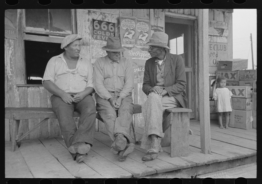 [Untitled photo, possibly related to: Negroes talking on porch of small store near Jeanerette, Louisiana]
